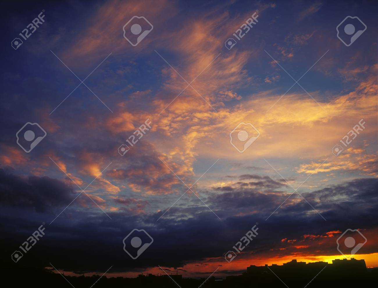 The magnificent sky and clouds in last beams of the sun. - 15654597