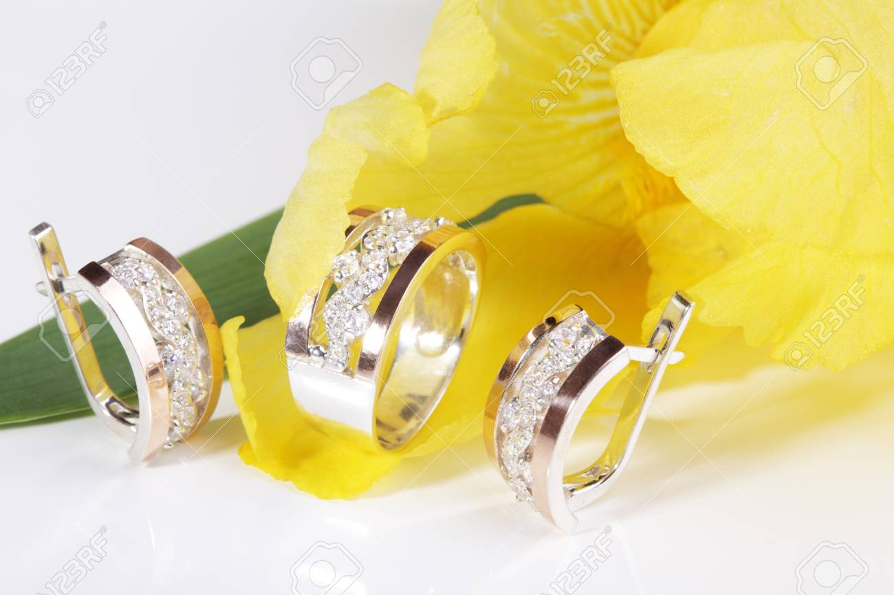 Beautiful Gold Ring And Earrings On A Yellow Flower Stock Photo