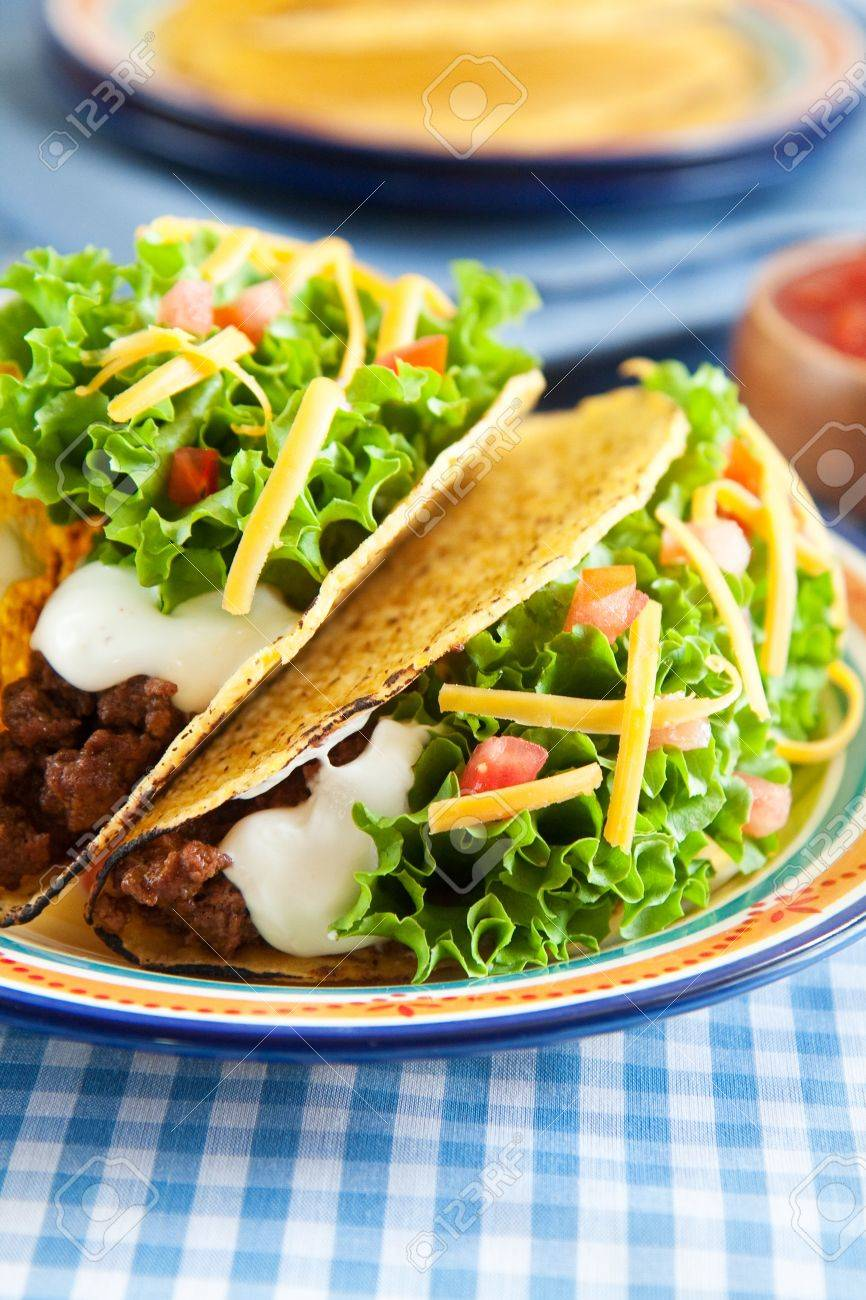 Deluxe hard shelled beef tacos served with salsa Stock Photo - 10130914