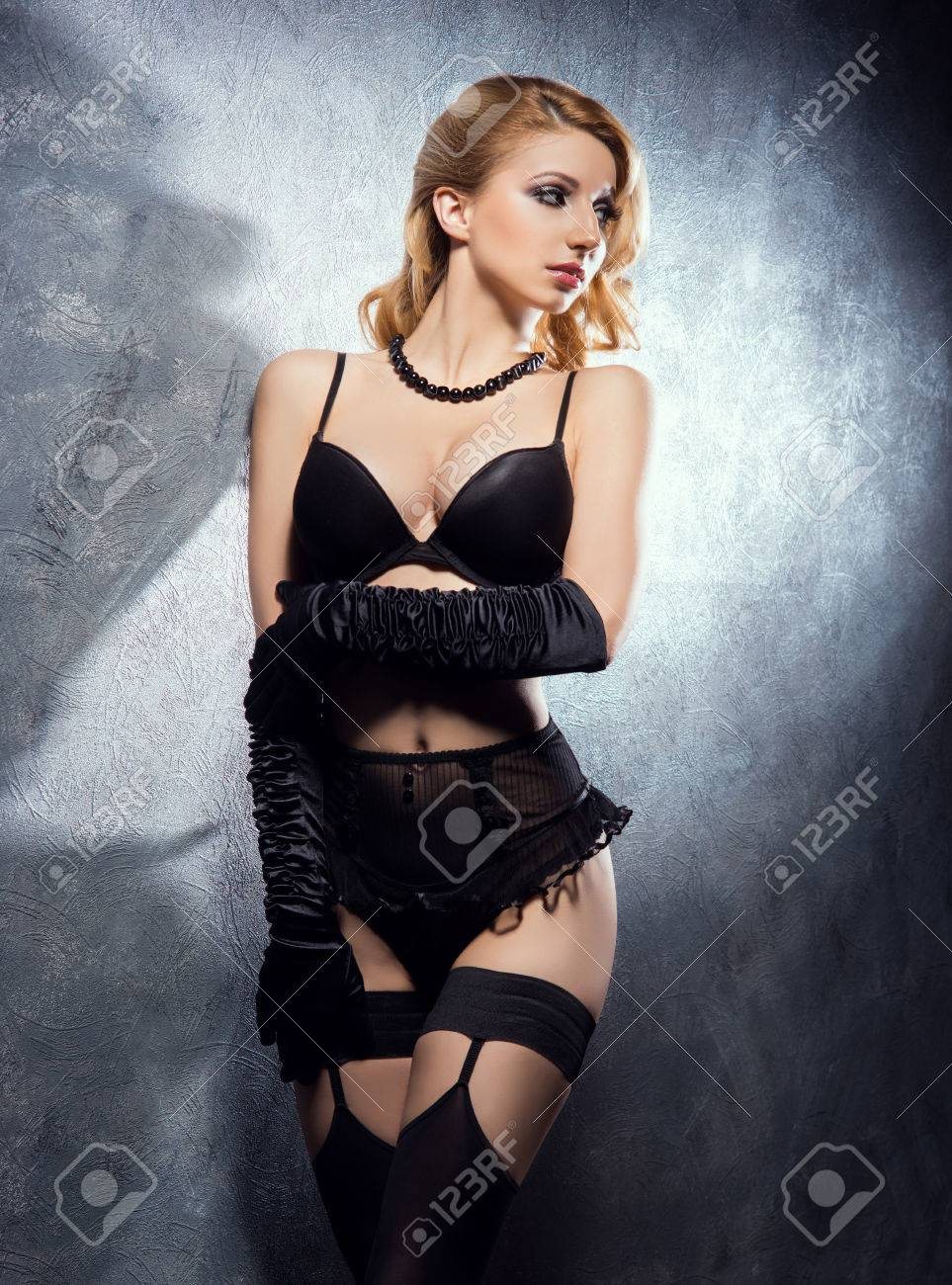 38360eaeb51 Stock Photo - Young and beautiful cabaret dancer in sexy vintage lingerie
