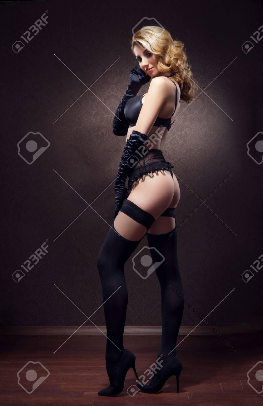 2083184d9f8 Stock Photo - Young and beautiful cabaret dancer in sexy vintage lingerie  over retro background