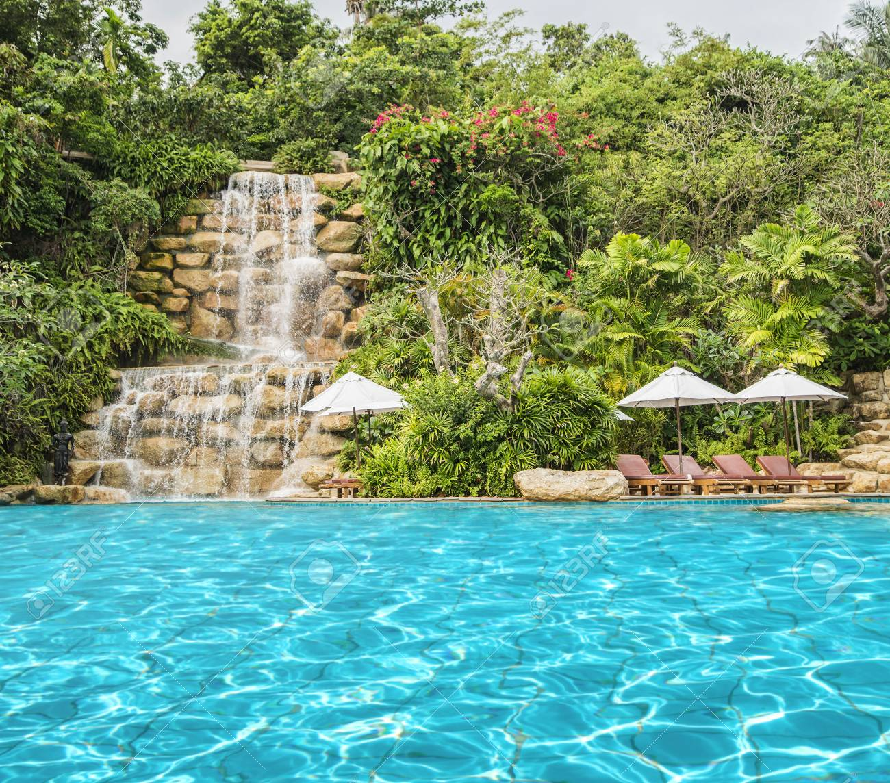 Paradise For Tourists With Crystal Clear Swimming Pool, Deckchairs ...