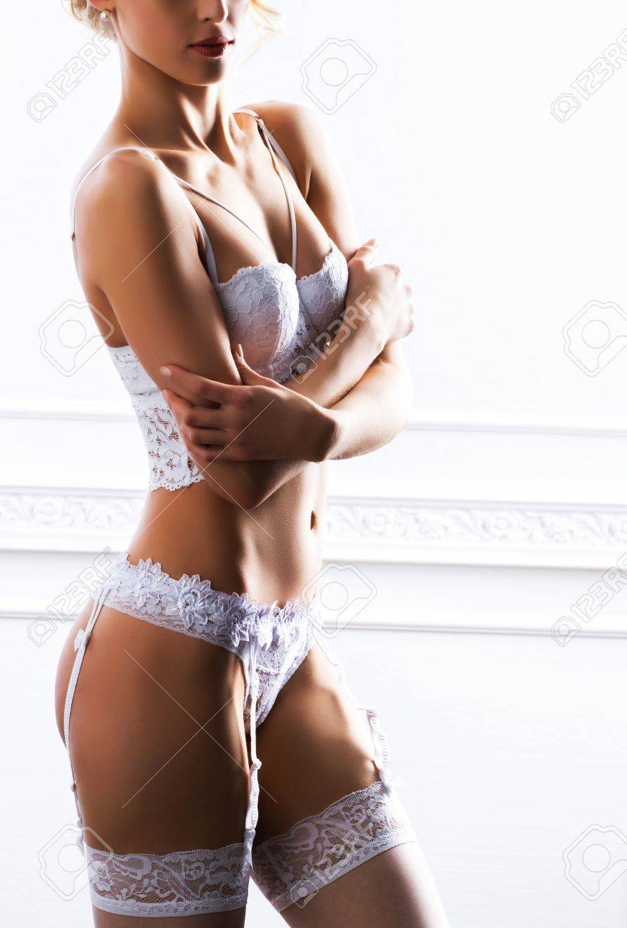c959f7a490cf Close-up photo of young and sexy bride in underwear and stockings. Woman in