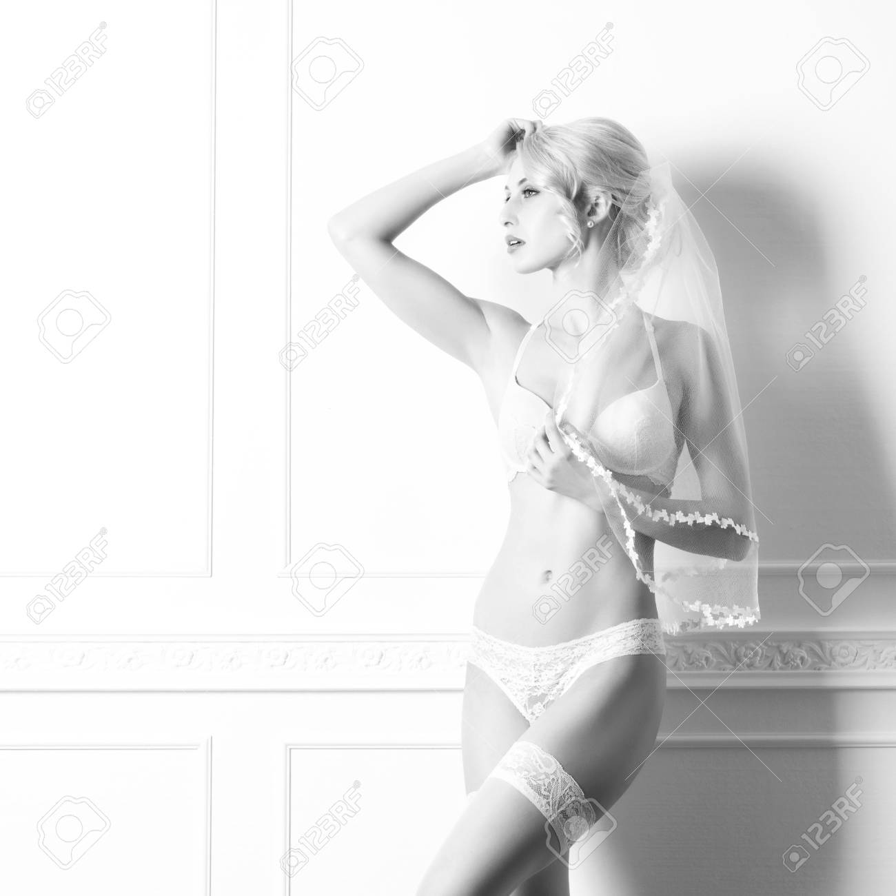 37f7b7697560 Black and white photo of sensual and beautiful young woman in a bridal  lingerie over retro