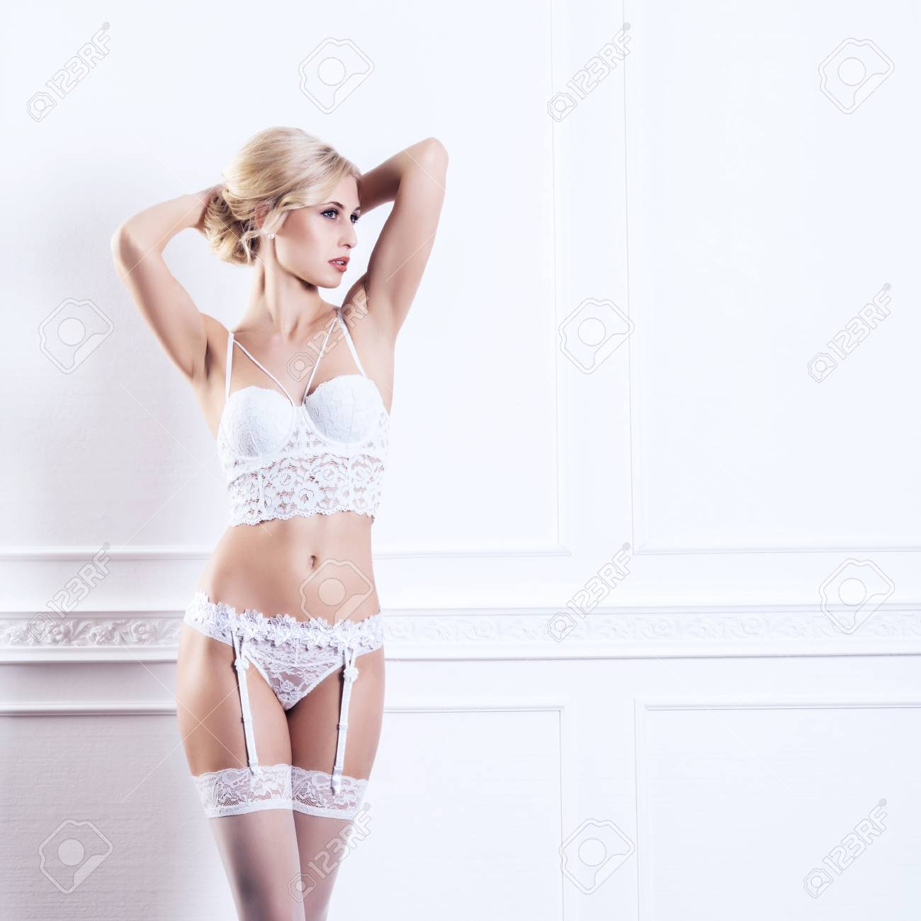 1cec413531b Sexy and beautiful young girl in a bridal underwear. Bride in erotic  lingerie and hosiery