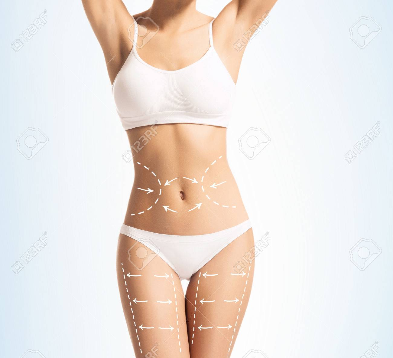 Women Slim Body In Swimwear Having Arrows Along Her Stomach And Stock Photo Picture And Royalty Free Image Image 73867254