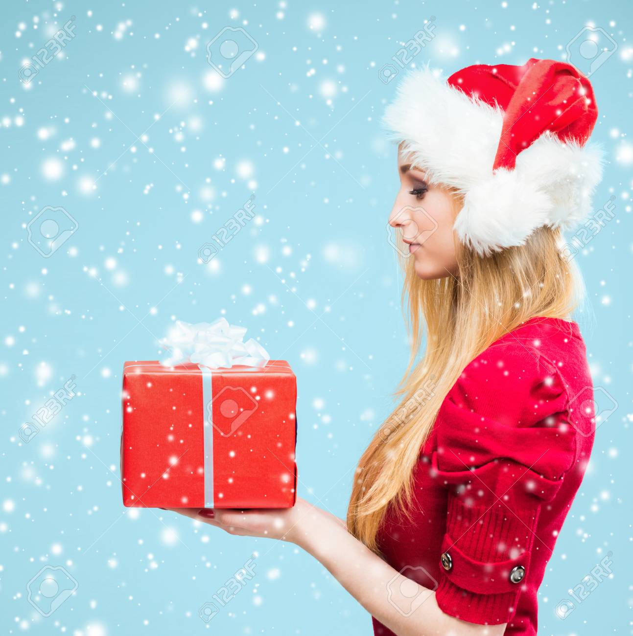 Portrait Of Attractive Blond Woman Over Christmas Background