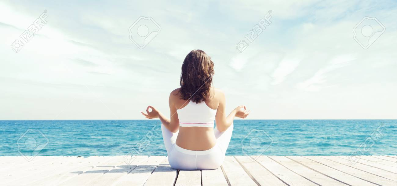 Woman Meditating In Lotus Position Outdoor Yoga Zen Buddhism Recovery And Wellbeing