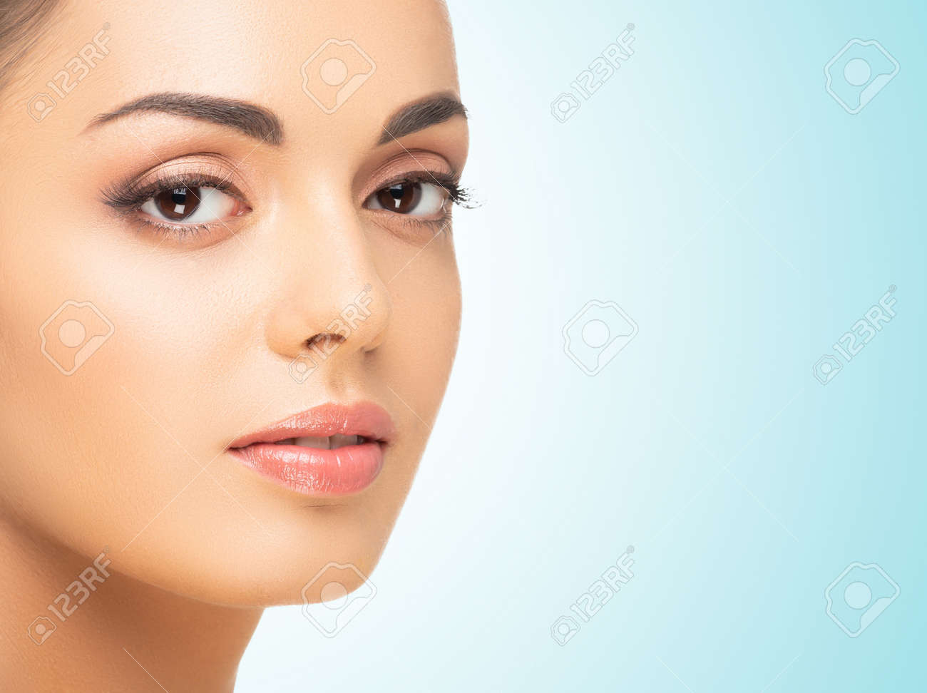 Beautiful face of young and healthy woman. Spa, cosmetology and healthcare. - 167105632