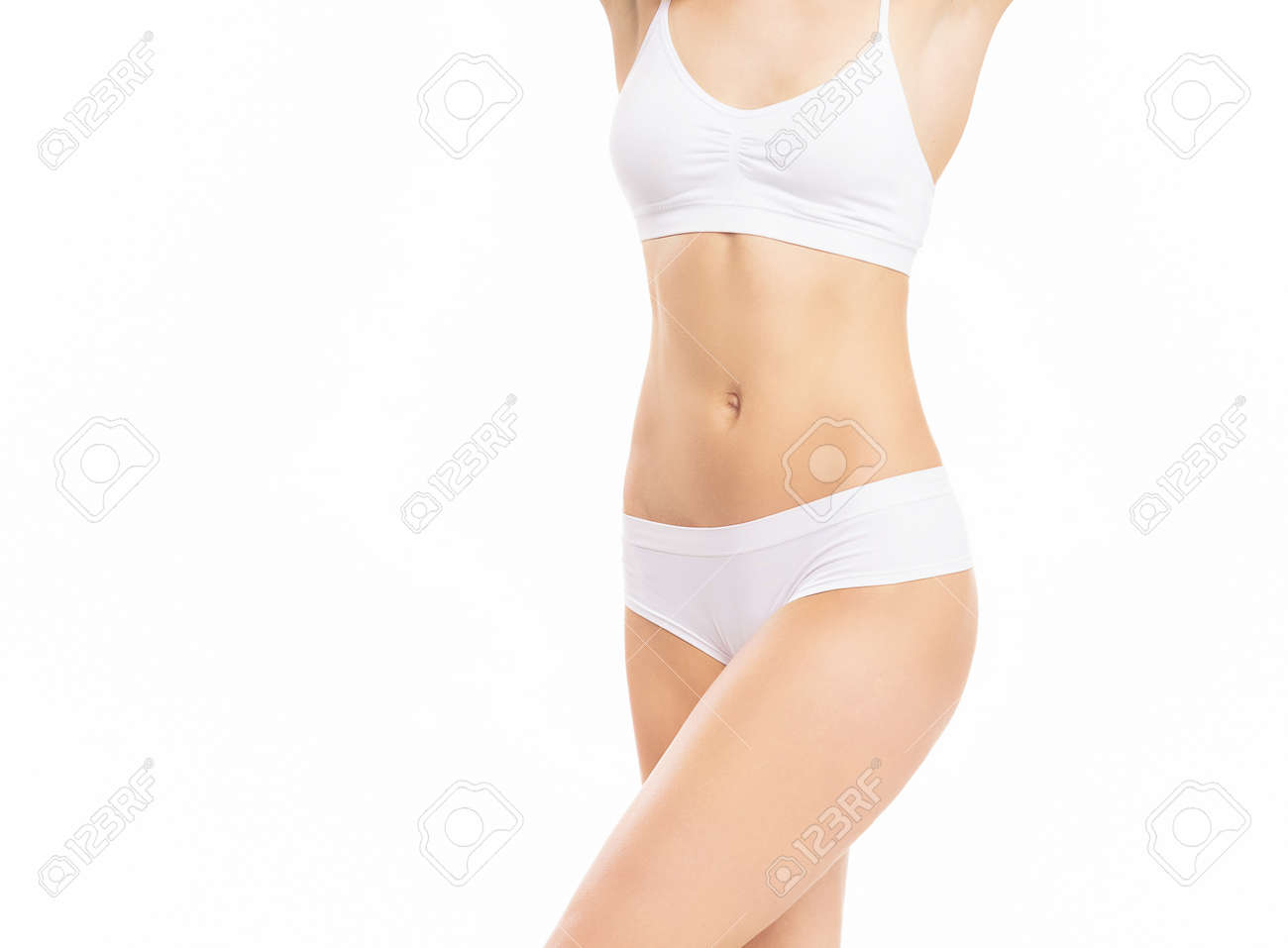Close-up of a beautiful and fit female figure. Studio photo of young womans body in swimsuit. - 167688412