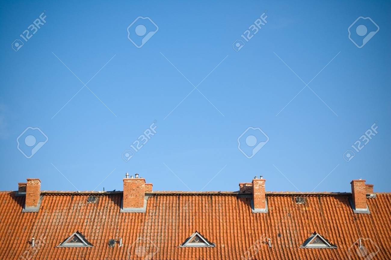 Old, red roof against clear, blue sky Stock Photo - 13047826