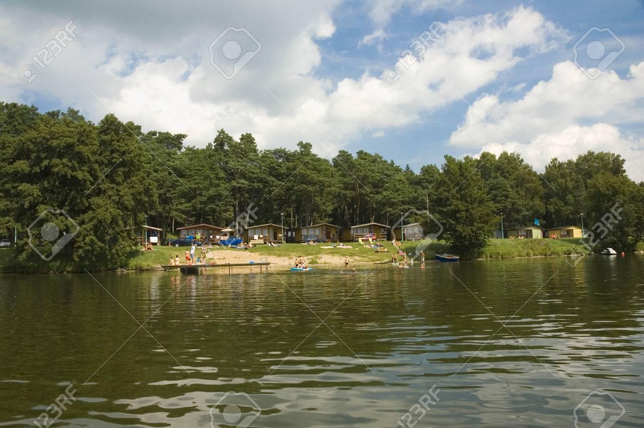 Camp site on the lake shore in Masuria district, Poland Stock Photo - 25228889