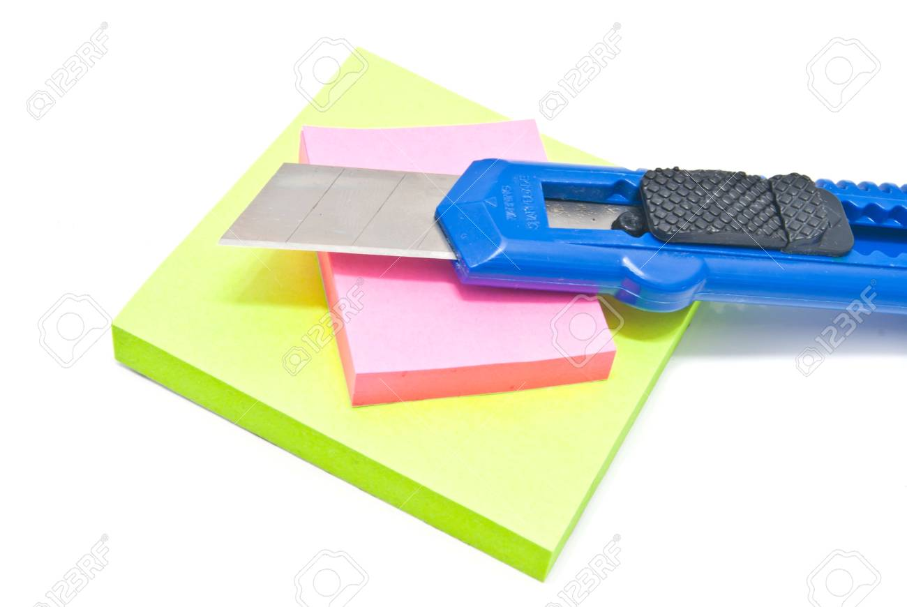 office knife and sticky notes on white Stock Photo - 17094798