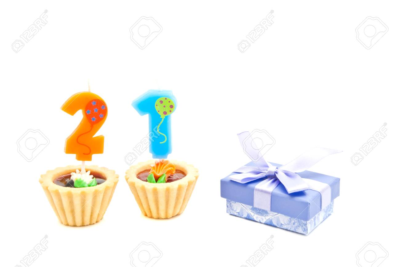 Cakes With Twenty One Years Birthday Candles And Gift On White Stock Photo