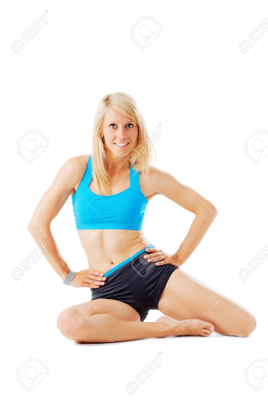 Blonde woman sitting on the ground with hands on her hips smiling isolated on white Stock Photo - 20953173
