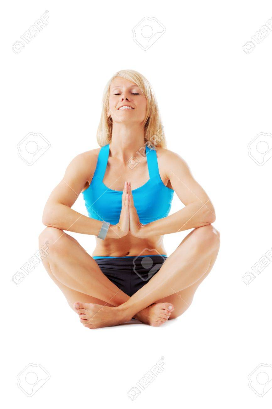 Blonde woman sitting with legs crossed meditating isolated on white Stock Photo - 20953174