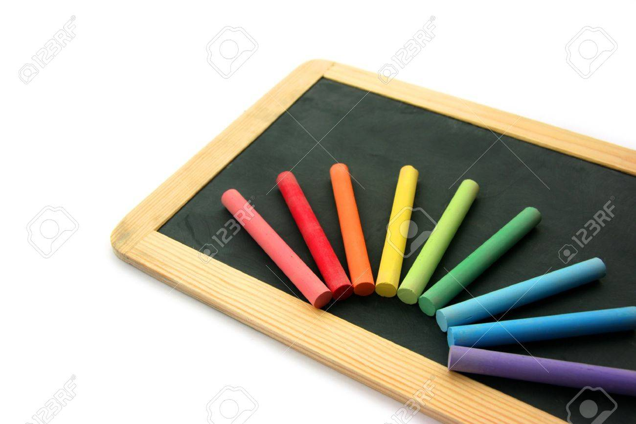 Small school wooden blank blackboard and multi color chalks isolated on white background Standard-Bild - 4024012