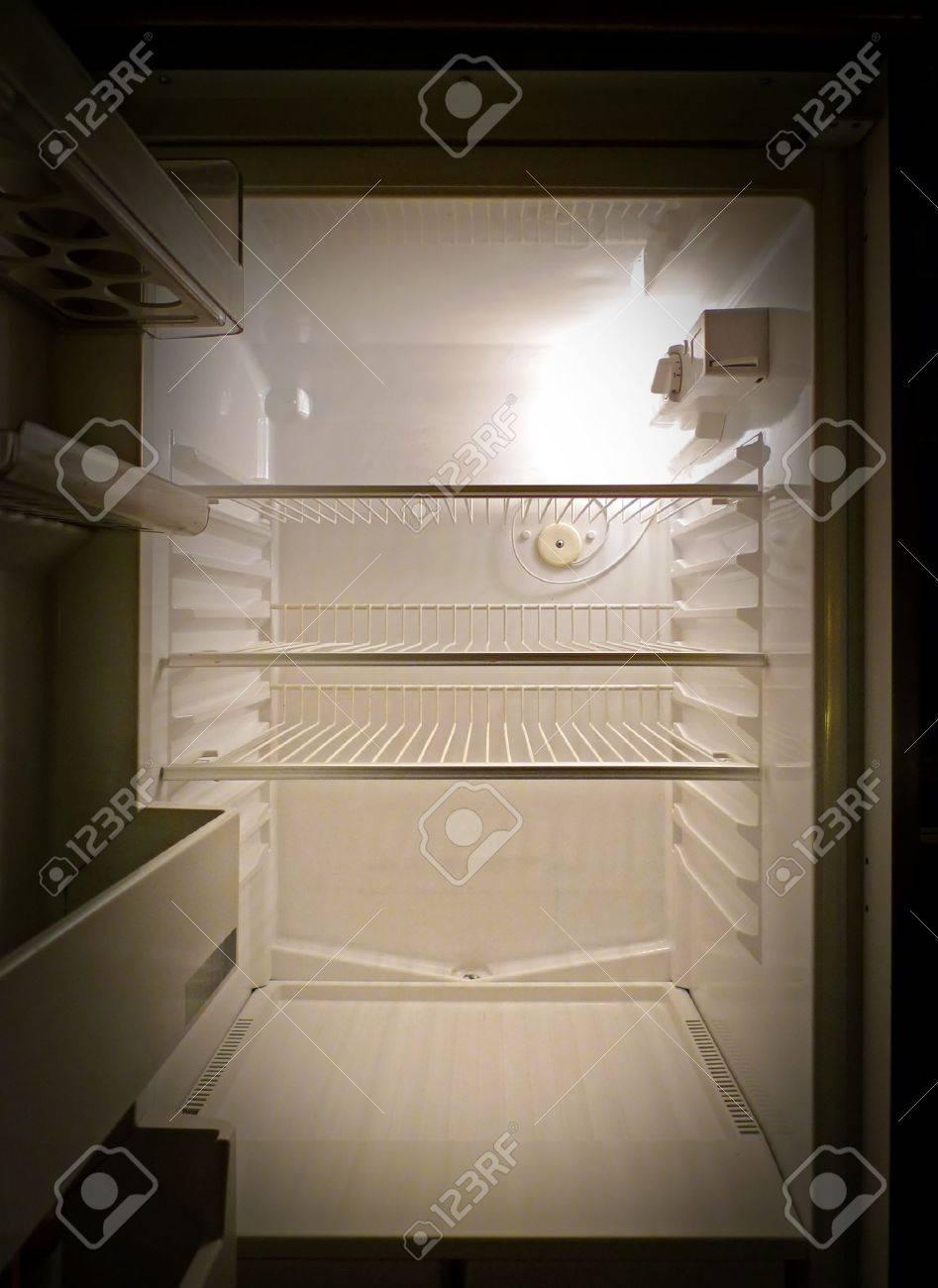 Interior of an empty fridge lit by the internal lamp Standard-Bild - 5077748