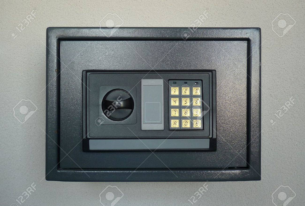 small home or hotel wall safe with keypad closed door stock photo