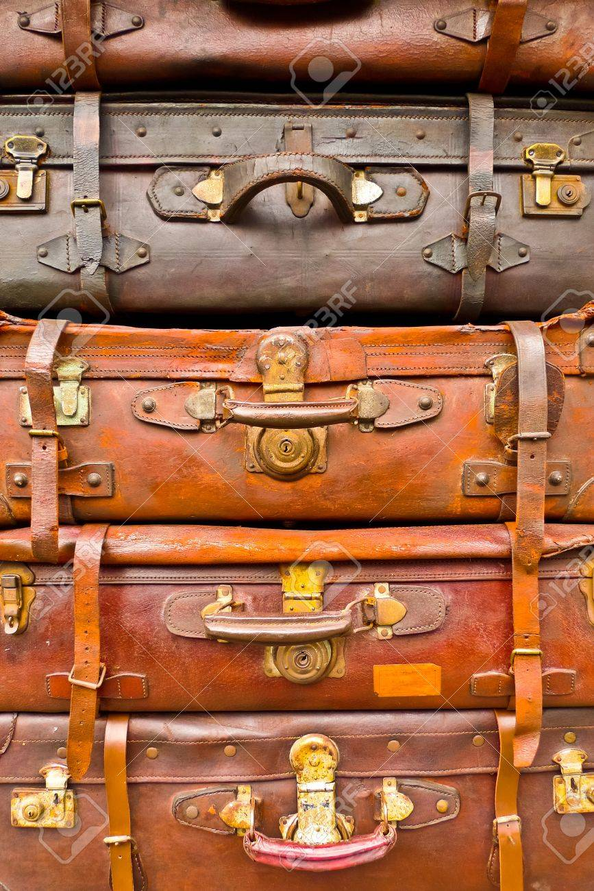 Vintage battered brown bags stacked vertically Standard-Bild - 17591878