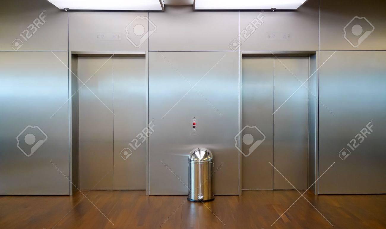 Two brushed metal elevator doors in a minimalistic style building interior Standard-Bild - 17753354