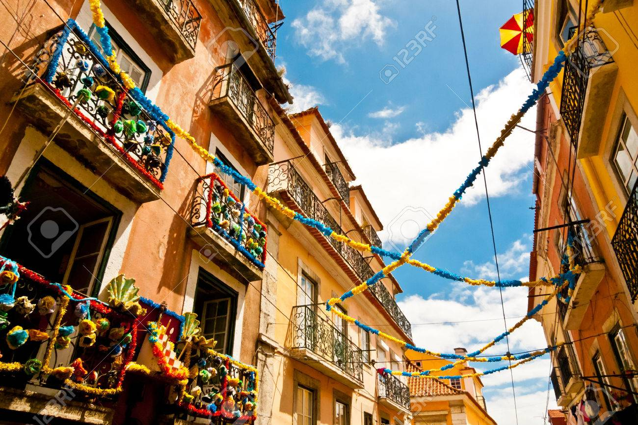 Balconies on a colorful decorated alley in Barrio Alto during the Festival of Santo Antonio, Lisbon, Portugal Standard-Bild - 34169074