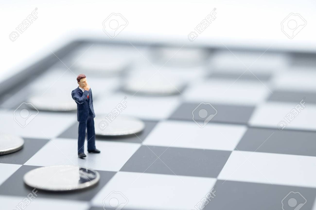 Businessman Miniature People Figure Standing On Chessboard With