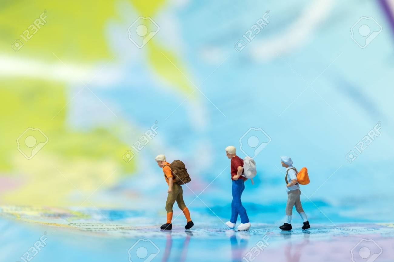 Travel concepts group of traveler miniature mini figures with stock photo travel concepts group of traveler miniature mini figures with backpack walking on world map gumiabroncs Images