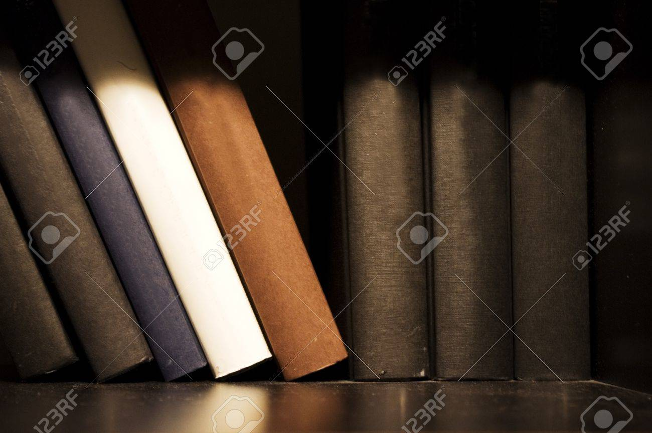 a close up shot of book on shelf, indoor setting. Stock Photo - 9965619
