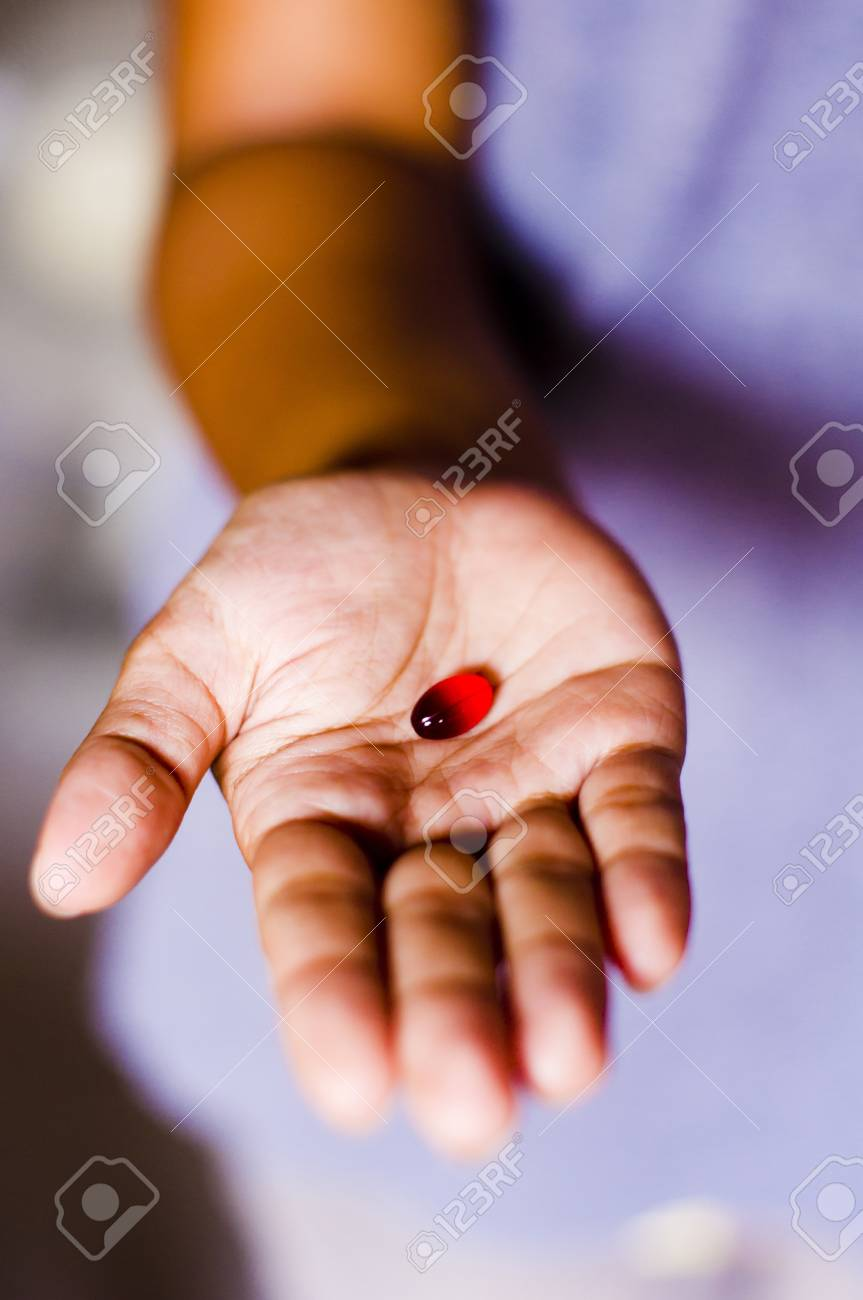a red tablet is handed out by a woman. Stock Photo - 11753215