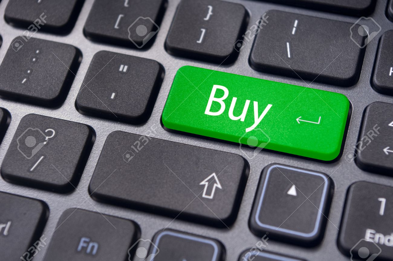 a buy message on keyboard key, for online shopping or stock market investment concepts. Stock Photo - 13314083