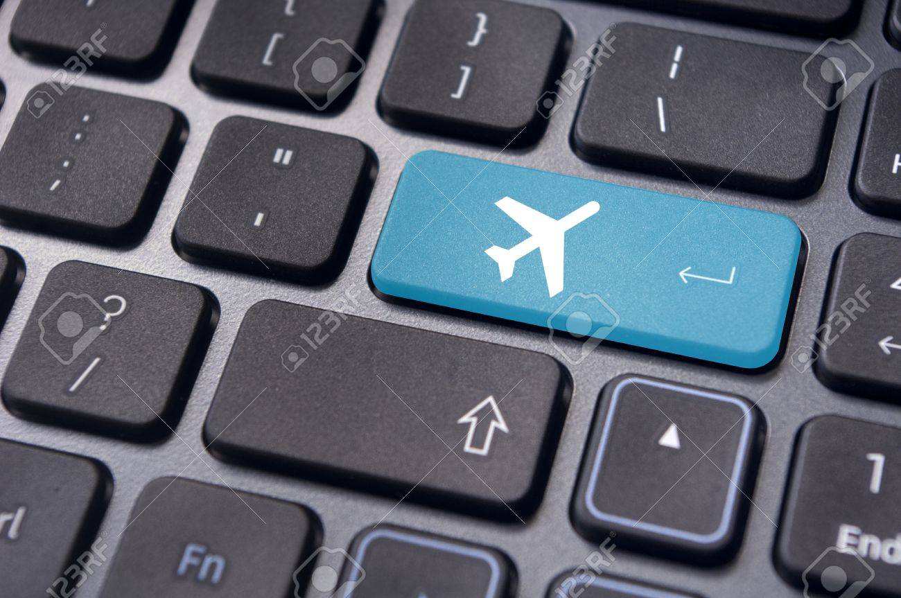 a plane sign on keyboard, to illustrate online booking or purchase of plane ticket or business travel concepts. Stock Photo - 20325086