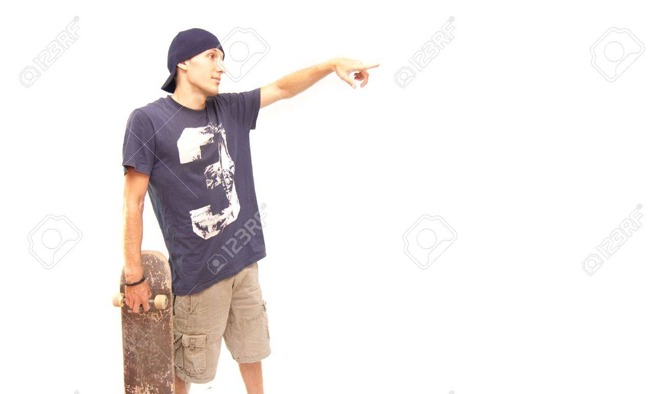 a skater with a old skate pointing his finger on something Stock Photo - 5440964
