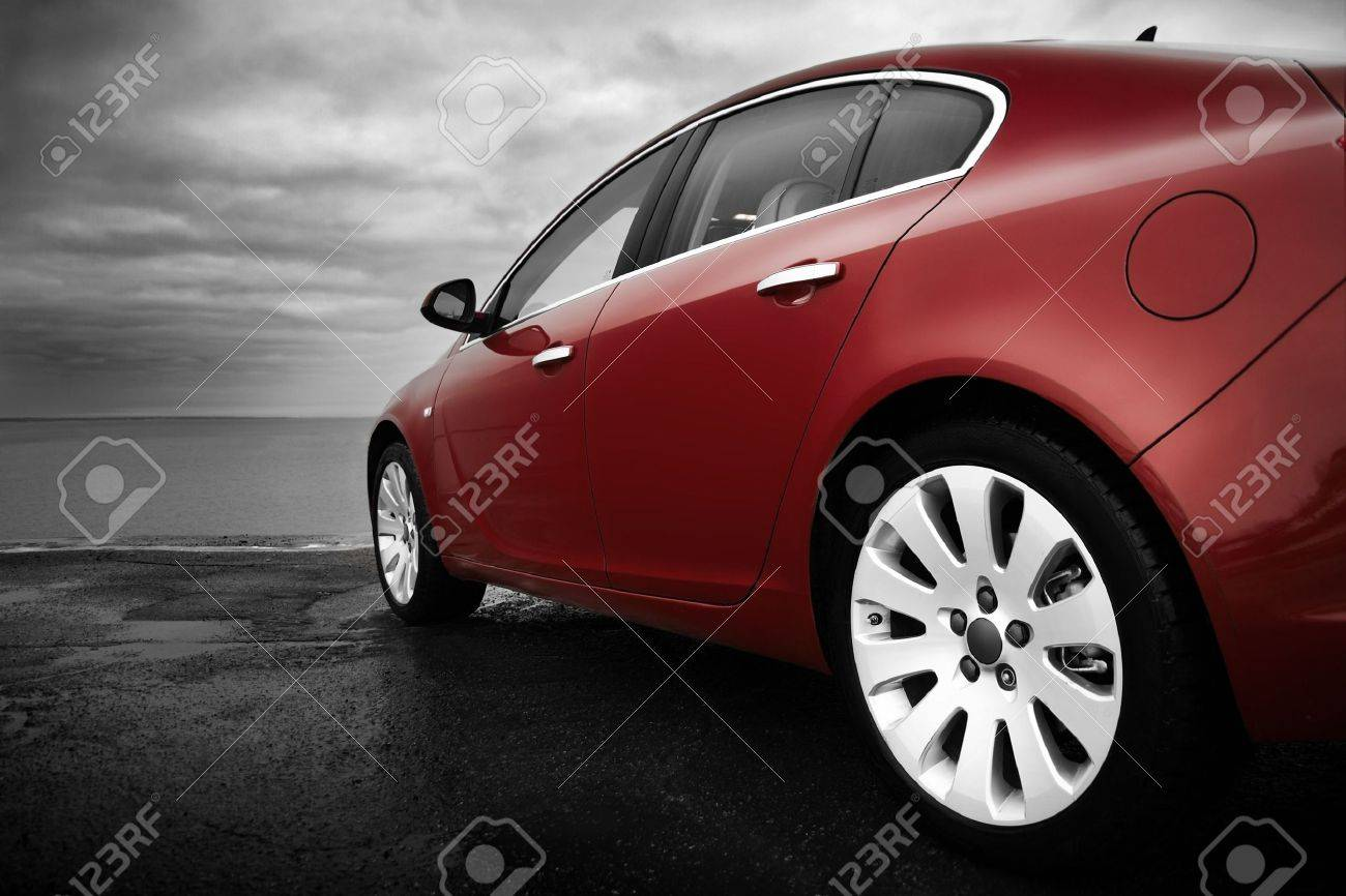 Rear-side view of a luxury cherry red car with monochrome background Stock Photo - 4627404
