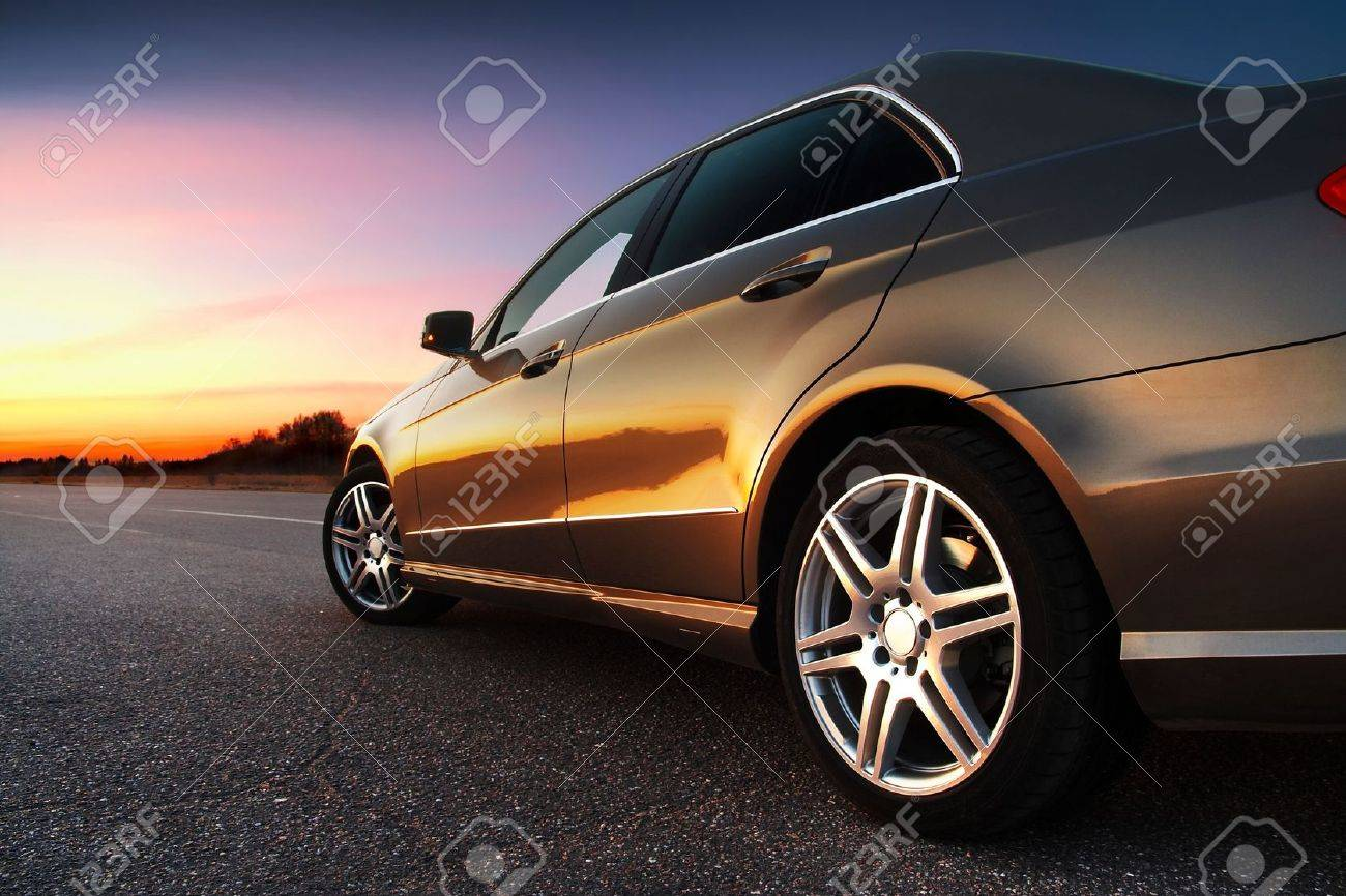 Rear-side view of a luxury car on sunset Stock Photo - 4772243