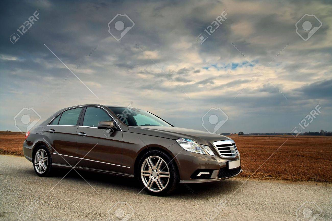 Front view of a luxury car on country road with dramatic sky Stock Photo - 5322652