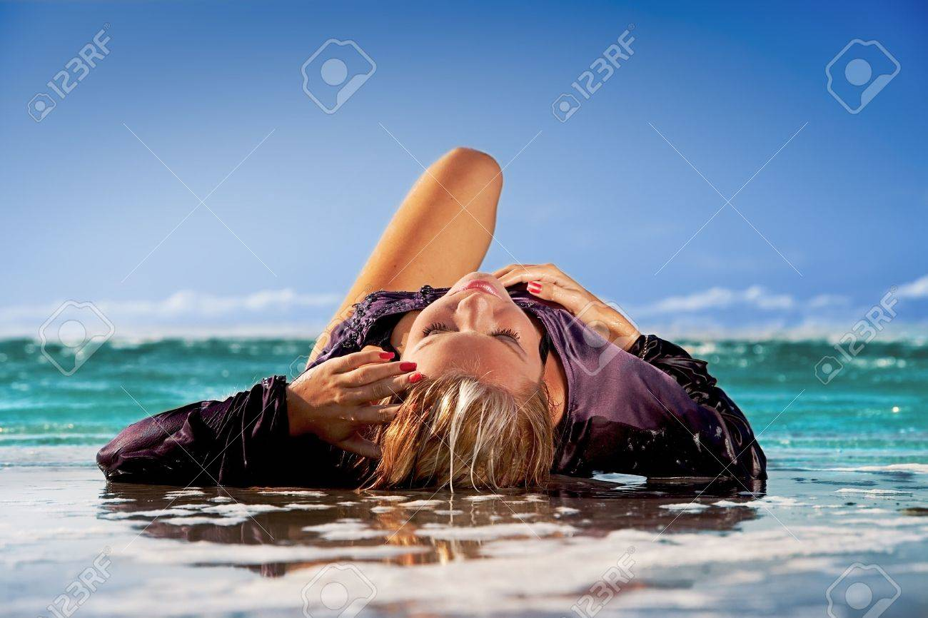 Wet girl enjoying sun and water in tropical sea Stock Photo - 5372576