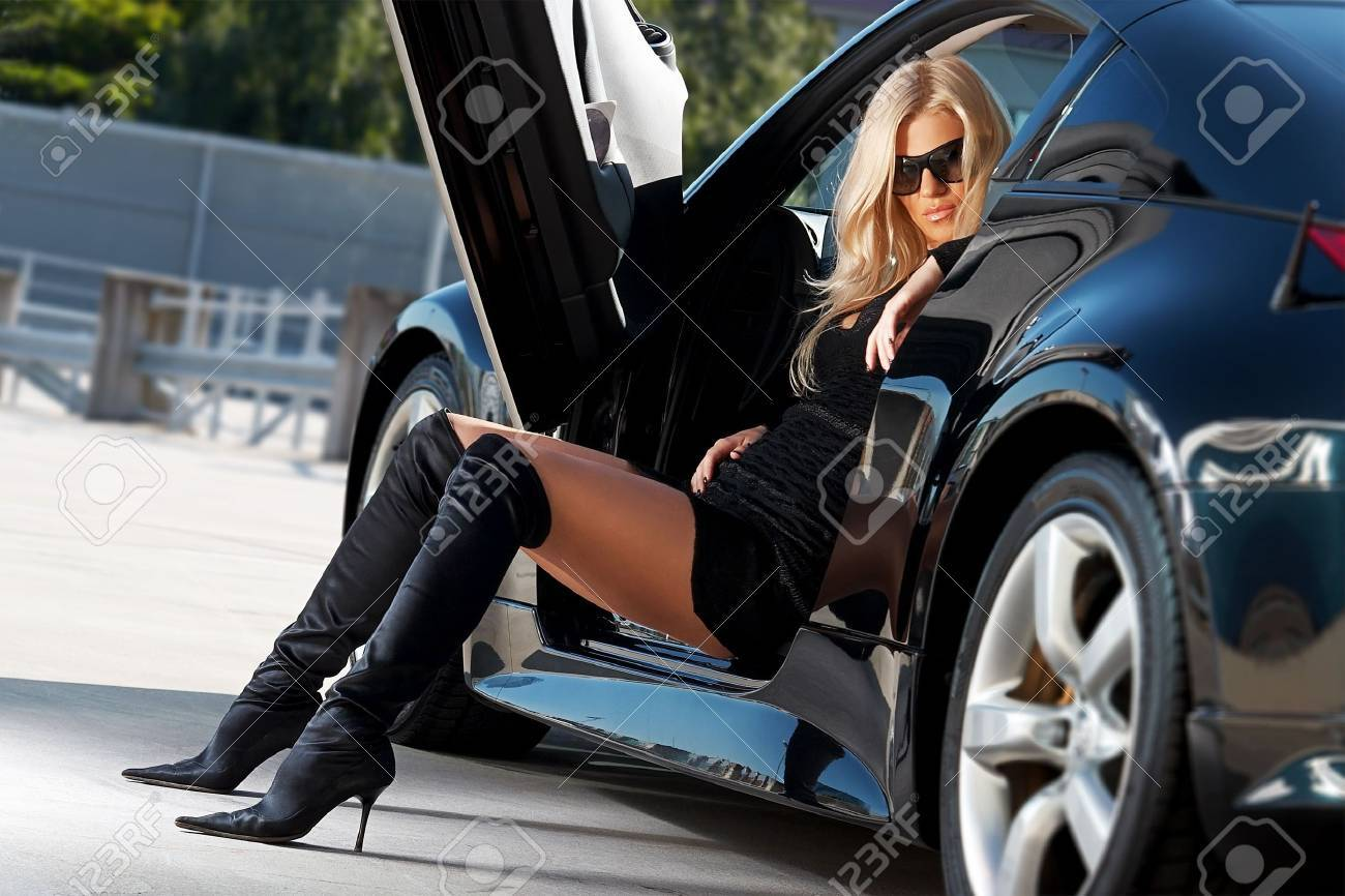 Glamorous blond babe sitting in tuned supercar Stock Photo - 5591883