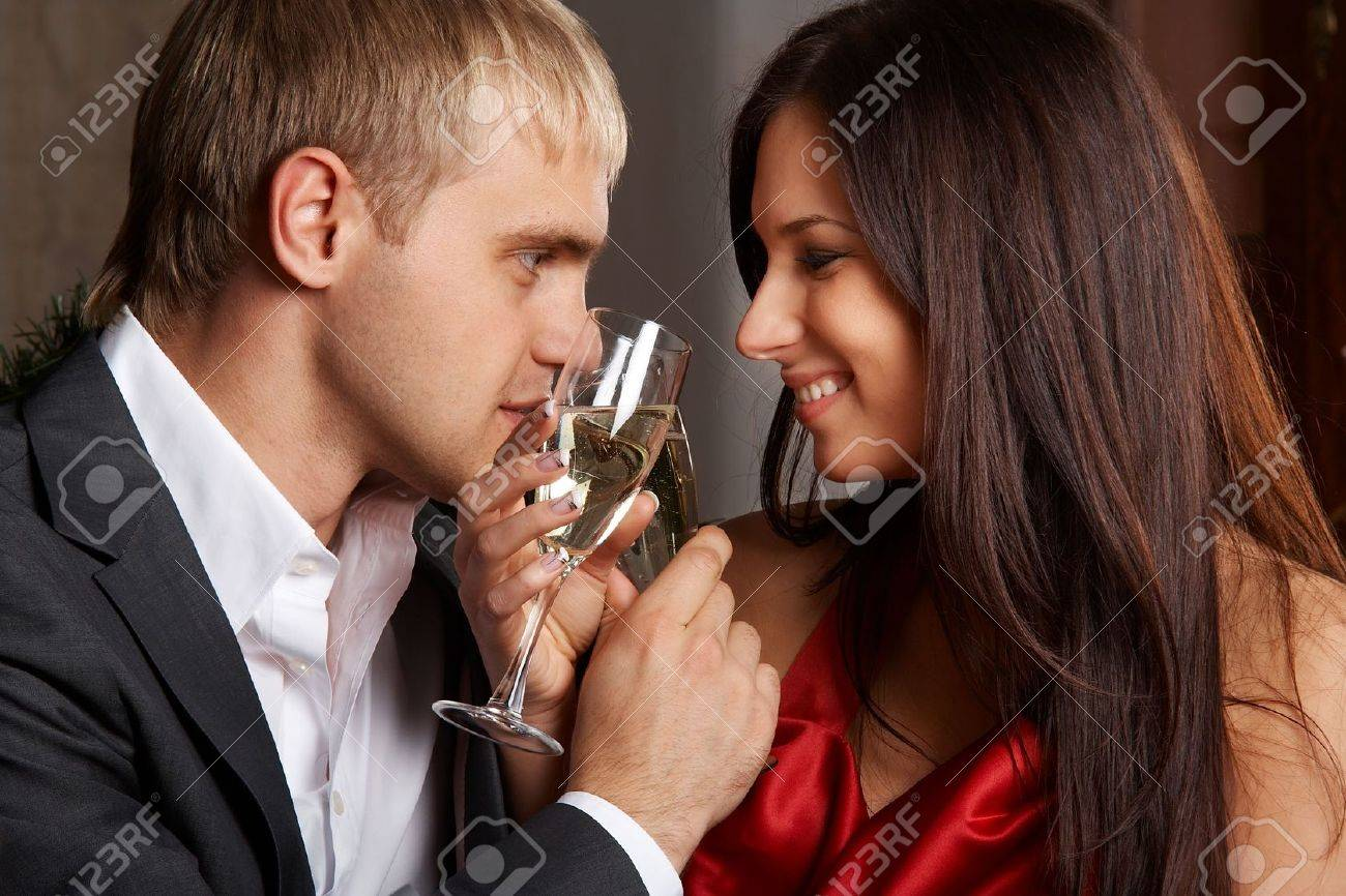 Young happy couple with champagne glasses at celebration Stock Photo - 5705502