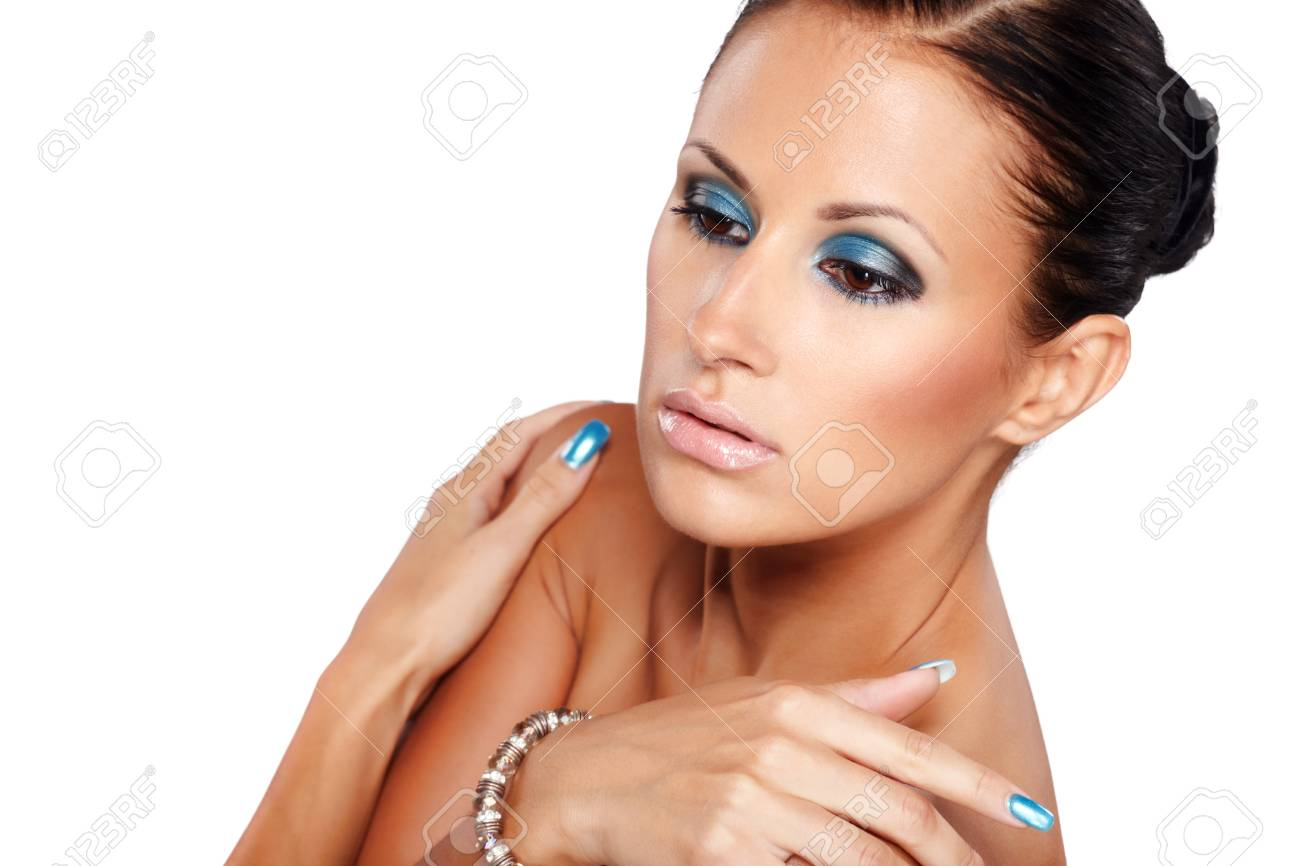 Portrait of beautiful lady showing blue nails isolated on white Stock Photo - 7684492