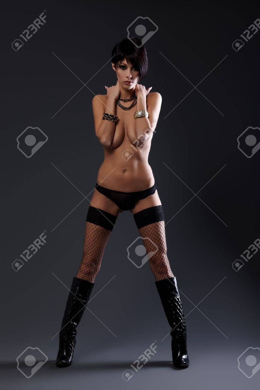 Brunette lady in black lingerie on grey background Stock Photo - 8314438