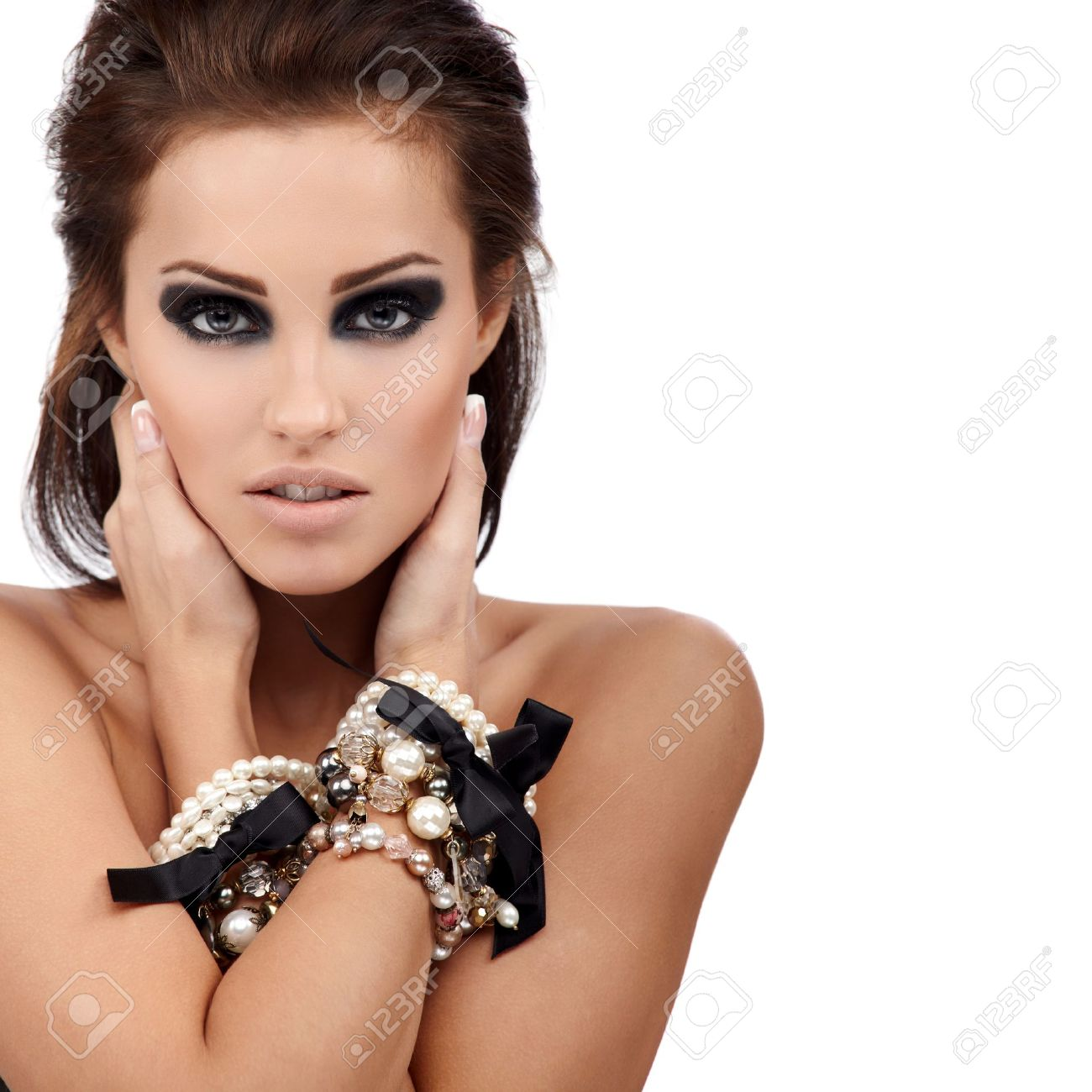 Young brunette lady with luxury accessories isolated on white background Stock Photo - 8314469