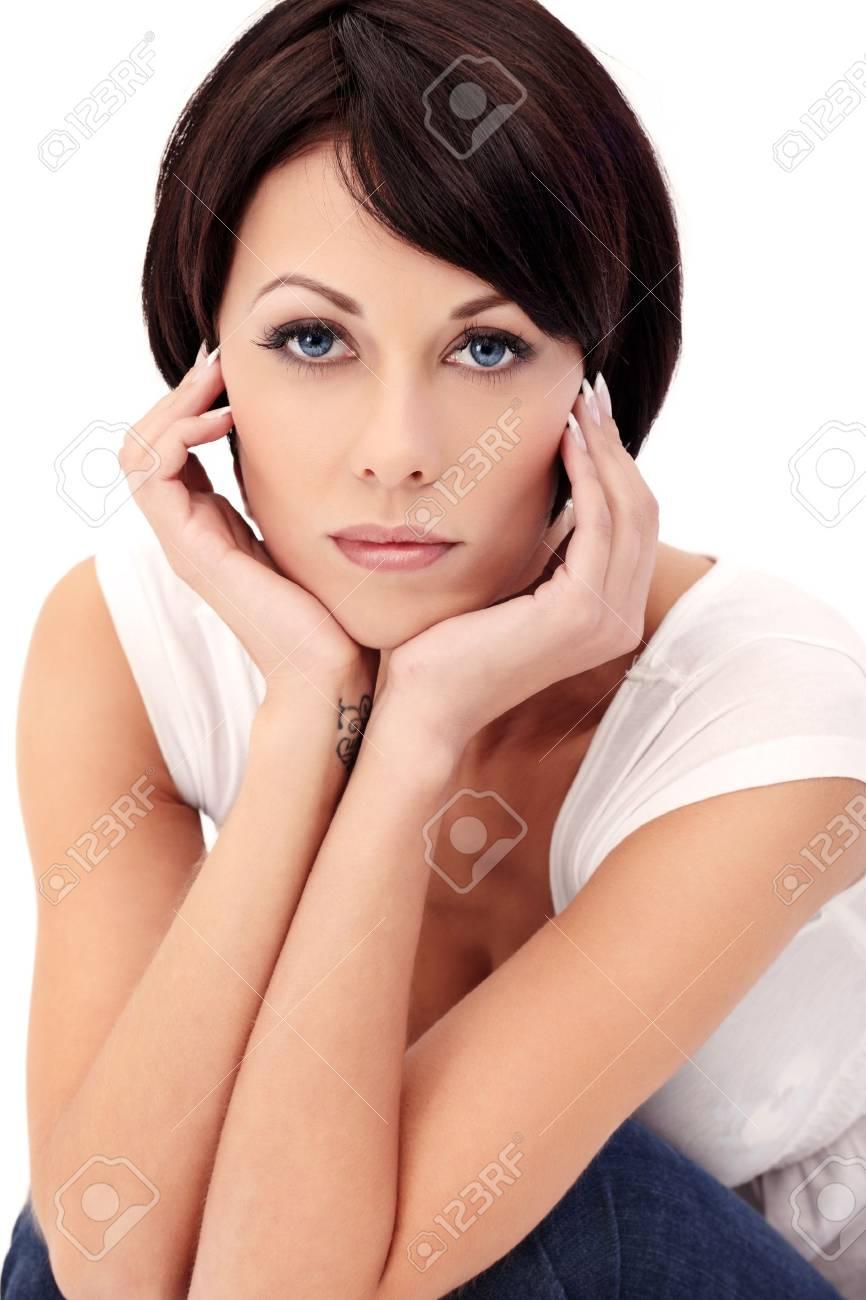 Closeup portrait of brunette female model with blue eyes on white background Stock Photo - 8314454