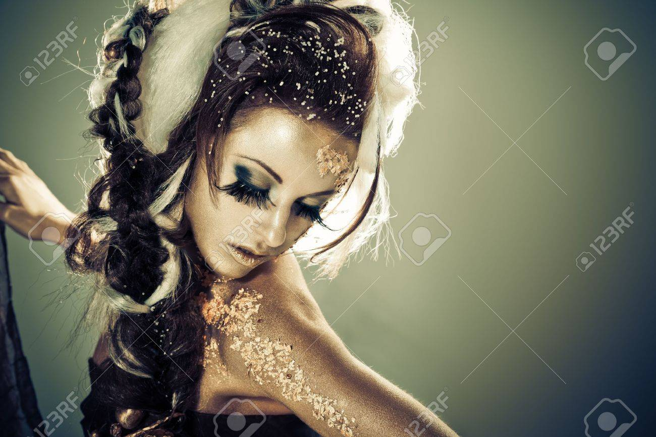 Vogue style portrait of a woman with gold-silver bodyart and makeup Stock Photo - 8342830