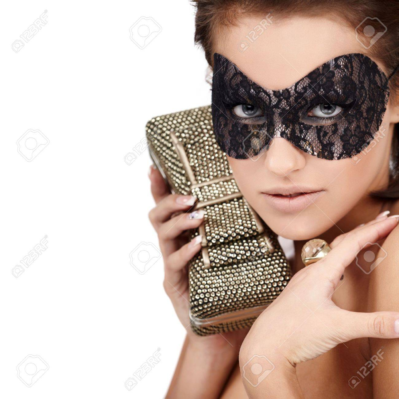 Young brunette lady with luxury accessories isolated on white background Stock Photo - 8342829