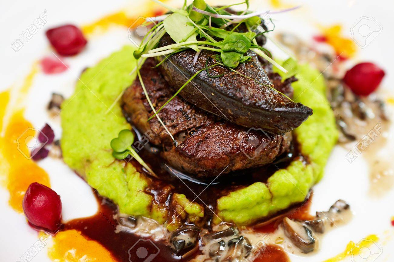 Fillet Of Beef With Elk Liver Served With Mashed Potatoes And