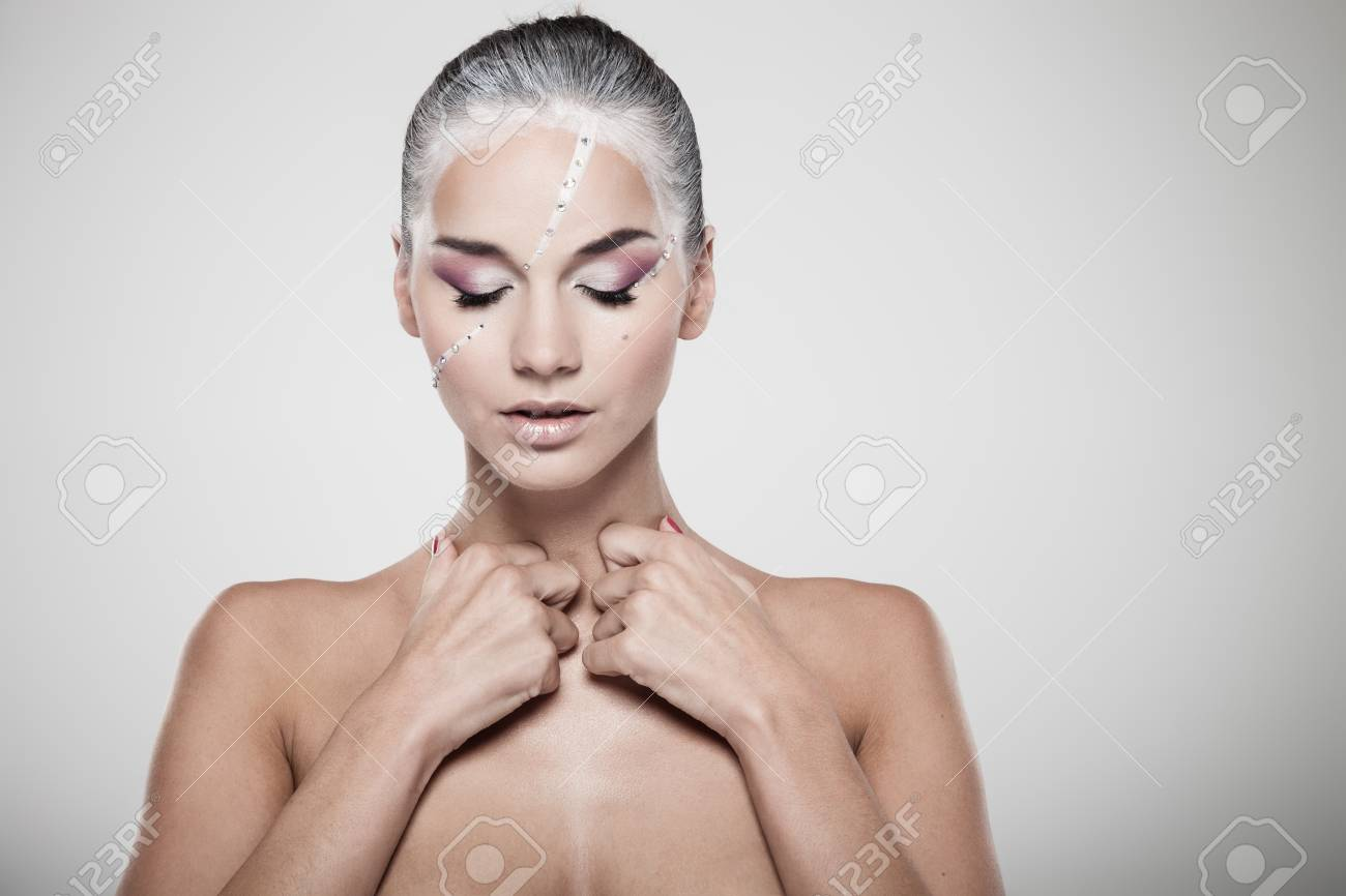 Portrait of a model with fashionable makeup on gray background Stock Photo - 15483159
