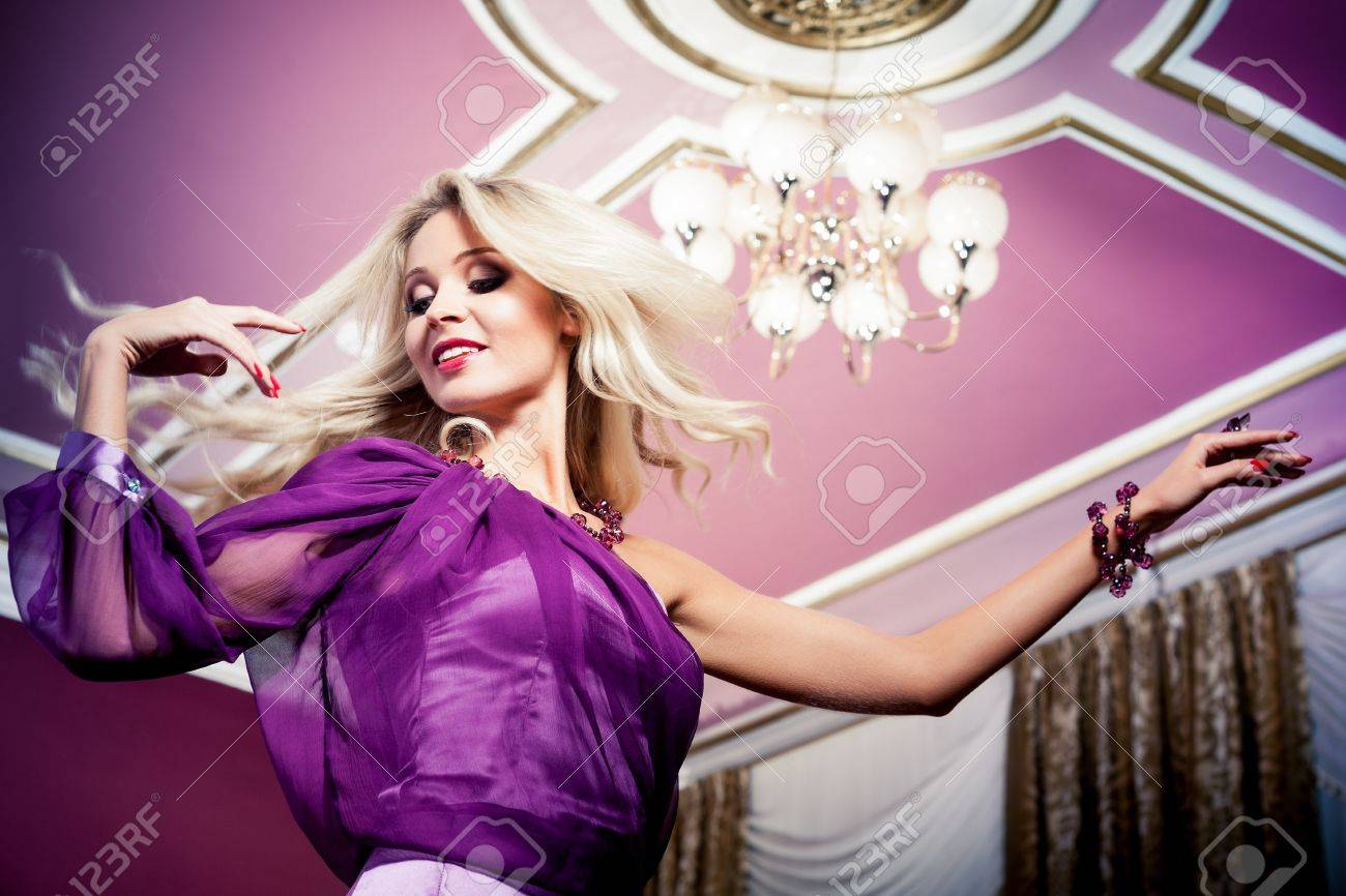 Beautiful blond woman in vintage interior Stock Photo - 17501685