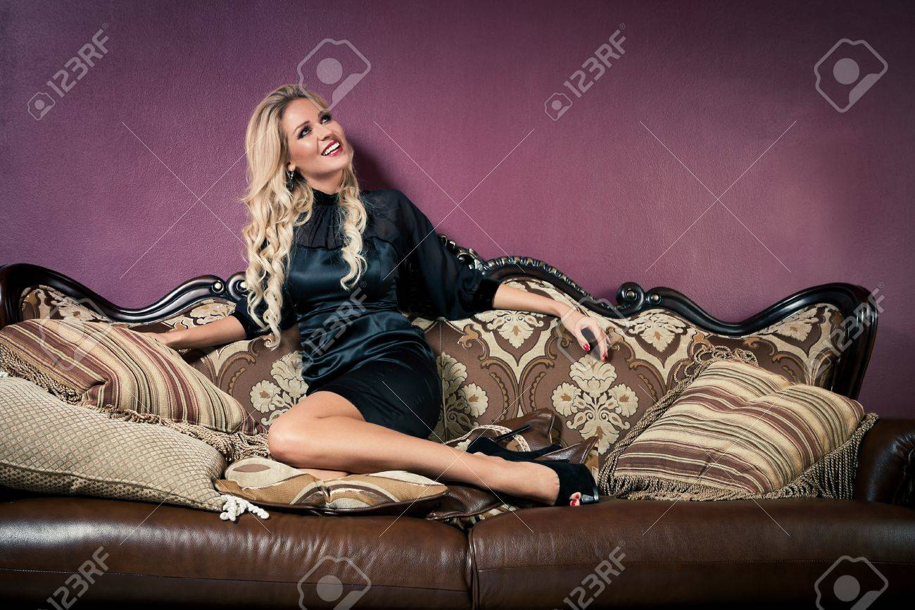 Beautiful blond woman in vintage interior Stock Photo - 17445105