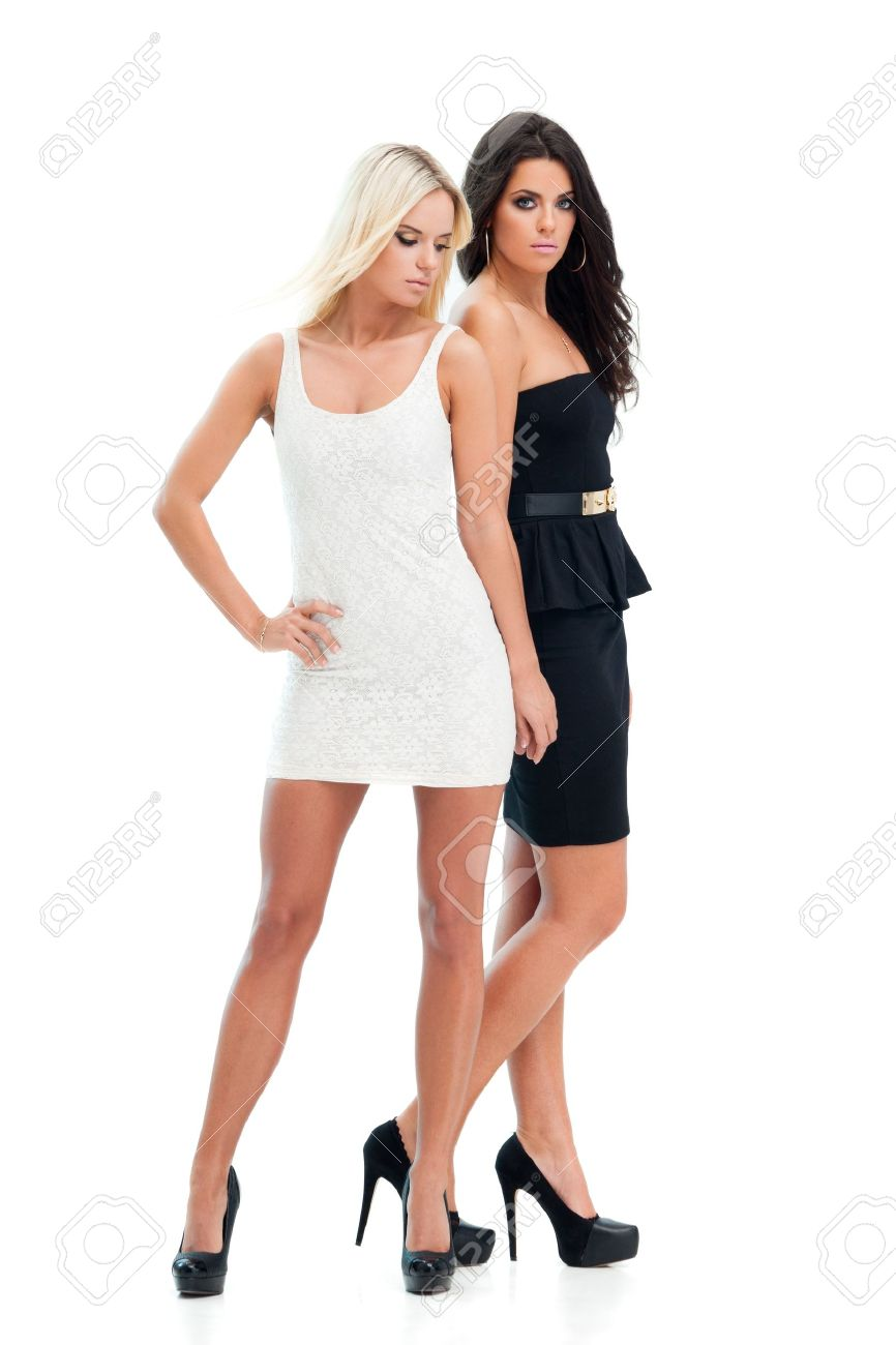 Two happy girlfriends posing on white background Stock Photo - 17566285